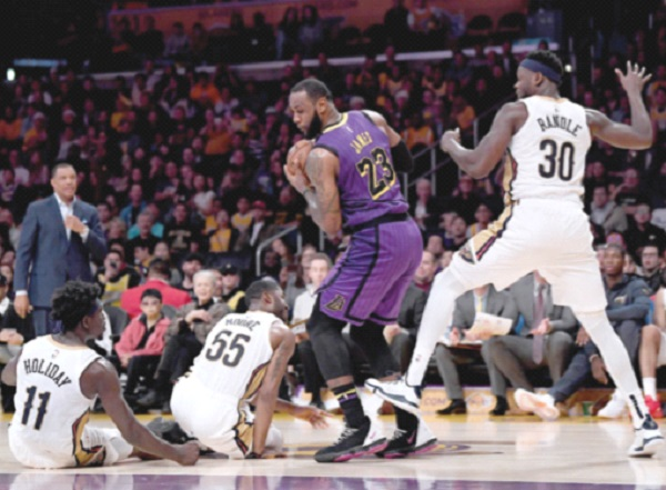 fe4c71c9be LOS ANGELES  LeBron James shook off flu-like symptoms to post his third  triple-double of the season Friday and lead the Los Angeles Lakers to a 112- 104 NBA ...